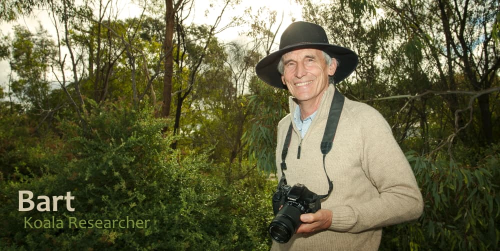 Koala researcher with camera